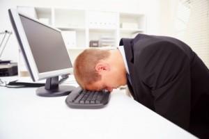 stress-hitting-head-on-keyboard